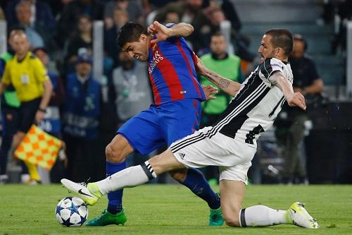 Luis Suarez vs Leonardo Bonucci - credits: MARCO BERTORELLO / AFP / picturedesk.com